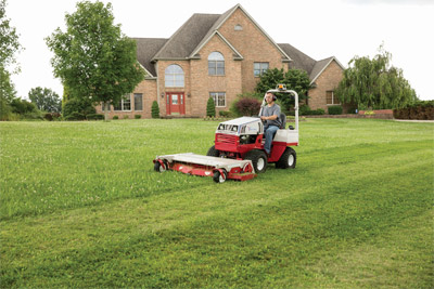 Manicured lawn with HM722 on Ventrac 4500 - The HM722 Complete Mowing Deck tackles large yards quickly yet efficiently.