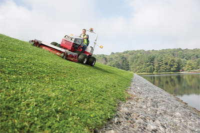 Ventrac 4500 AWD Slope Mowing Tractor - Shown using the HM722 Mowing Deck, finish mower, for a perfect cut even on slopes.