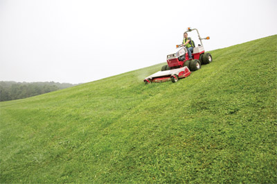 Downhill mowing Ventrac 4500 with HM722 - Shown here fitted with optional dual tires the Ventrac 4500 is more stable and safer on hills than zero turn mowers.