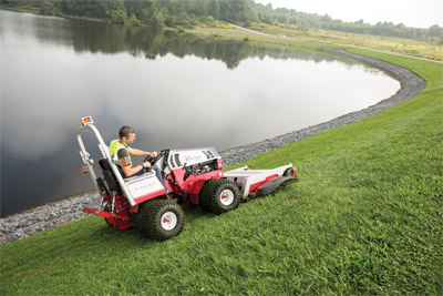 Safer slope operation with Ventrac 4500 - All-wheel drive and articulated steering help make the Ventrac safer in tough spots such as a grassy slope next to a lake or pond.
