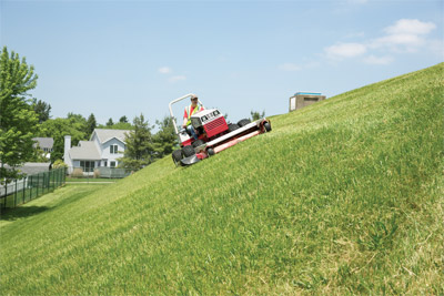 Ventrac 4500 Slope Mowing utility tractor - Shown with 72 inch finishing deck the Ventrac 4500 is safer on hills and slopes.