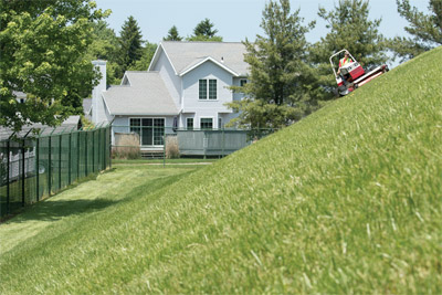 Ventrac 4500 AWD utility tractor Slope Mowing with HM722 profile - All wheel drive prevents slipping and tearing up turf while confidently maneuvering hills and slopes.