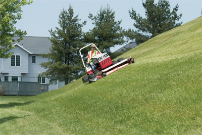 Ventrac 4500 AWD utility tractor Slope Mowing with HM722 close profile - The Ventrac 4500 is more stable and confident on slopes reducing turf damage while the 72 inch mowing deck leaves behind professional looking stripes and not high and low spots.