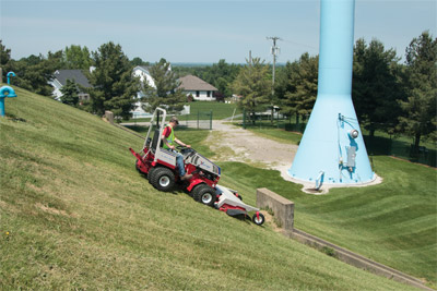 Ventrac 4500Y with HM722 Mowing Deck on steep hill - The all-wheel drive 4500 with weight transfer and (optional) dual wheels has the exceptional control to allow you to navigate hills and slopes both forward and reverse.