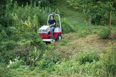 Ventrac Conquers Brush with Tough Cut - Create usable space out of an overgrown area faster and simpler with Ventrac.