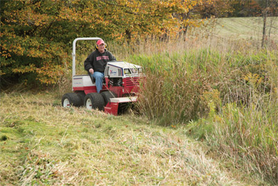 Ventrac 4500P using Tough Cut mower - See the difference Ventrac makes with hard to maintain and overgrown areas.