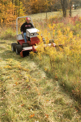 Ventrac 4500 with Tough Cut Mower clearing weeds - No need to hide indoors during allergy season. Take back your fields and overgrown areas with the Ventrac 4500 and Tough Cut mower.