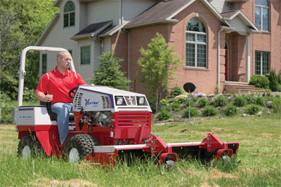 Ventrac 4500K mowing field - Shown using the HQ680 Tough Cut mower to maintain overgrown grass