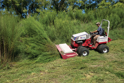 Ventrac 4500Z conquers the coppice - Small saplings and thick brush are much simpler to conquer using the Tough Cut mower for the Ventrac 4500. Pictured with optional dual wheels.