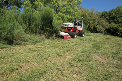 Ventrac using Tough Cut - HQ680 mower deck tackles heavy brush and growth.