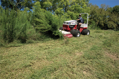 4500 using Tough Cut - Ventrac 4500 uses the Tough Cut mower to tame the wild growth of vegetation.