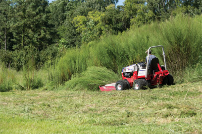 Ventrac 4500 and the Tough Cut versus Massive Weeds - Giant weeds that tower over the Ventrac 4500 are laid low by the HQ680 Tough Cut Mower Deck.