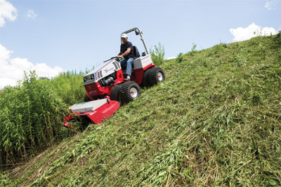 Ventrac 4500 downhill mowing with Tough Cut (zoom in) - Tall and unruly weeds can be a chore on hills and slopes without the stability and effectiveness of the Ventrac 4500 and Tough Cut deck.