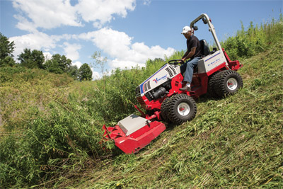 Ventrac 4500 downhill mowing with Tough Cut - The stability of all-wheel drive makes clearing thick brush possible with the Tough Cut mower deck.