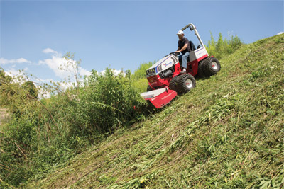 Ventrac 4500 downhill mowing with Tough Cut (zoom out) - Zero turn mowers and economy lawn tractors are incapable of safely tackling slopes, especially with thick overgrown brush, but the Ventrac 4500 with Tough Cut is designed to perform in such conditions much more safely.