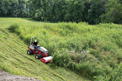 Ventrac 4500Z downhill brush mowing HQ680 - The Ventrac 4500 with Tough Cut mowing deck can simplify the task of clearing large hills of brush that only one person can do it all in far less time than a crew of people with trimmers.