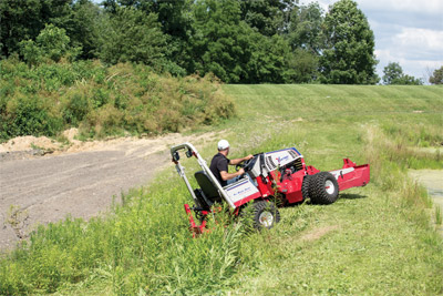 Ventrac 4500 climbing hills with AWD - All-wheel drive Ventrac tractors handle hills better than other tractors and articulated steering increases maneuverability for safer operation on slopes.