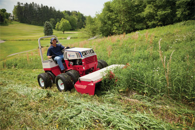 Ventrac 4500P Mowing fields with the Tough Cut - The Ventrac 4500 pictured with optional dual wheels mows an overgrown field with the Tough Cut mower deck.