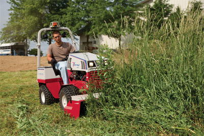 Ventrac 4500Y mowing tall grass with the HQ680 - Grasses and weeds exceeding six feet in height are reduced to a pile of mulched clippings with the Tough Cut mowing deck.