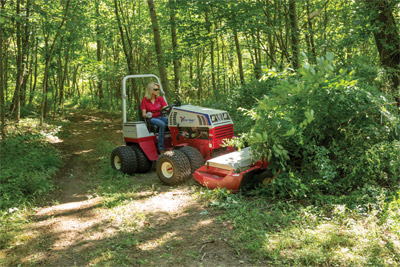 Ventrac 4500Z tackles saplings with the Tough Cut - The Tough Cut is capable of cutting tree saplings up to one inch in diameter. Tractor shown with optional dual tires.