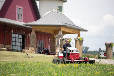 Picking Spring Flowers Ventrac Style - The HQ680 Mower Deck is powerful enough to take down one inch saplings yet can still neatly mow a field of wildflowers.