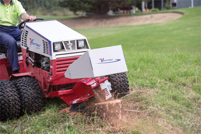 Ventrac 4500 and Stump Grinder - Tractor shown here with optional dual wheels.