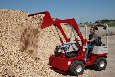 Ventrac 4500Y using Versa-Loader - The Versa-Loader can lift and carry five cubic feet of materials.