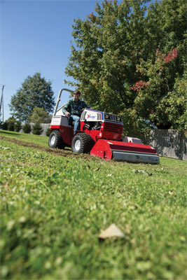 Ventrac 4500 using the KL480 Tiller - The Ventrac Tiller can even dig into grassy turf to dig new gardens or flower beds.