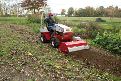 Ventrac 4500Z with Tiller - The Ventrac Tiller not only tills dirt but turns under dead vegetation to properly prepare a garden or flower bed.