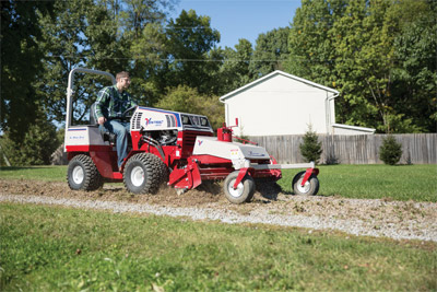 Ventrac 4500 with Power Rake in driveway - Power Rake stirs up compacted gravel to help repair driveways.