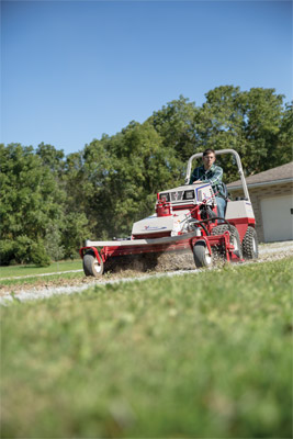 Ventrac 4500 with Power Rake driveway repair 01 - The Power Rake loosens gravel and turns under weeds to restore driveways.