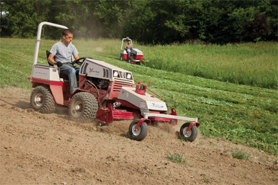 Two Ventrac 4500s hard at work - Foreground a 4500P uses the Power Rake while the 4500 in the back mows with the Tough Cut