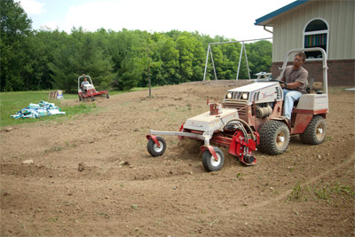 Ventrac 4500s play in the dirt - Front 4500 using the Power Rake and rear 4500 using Landscape Rake