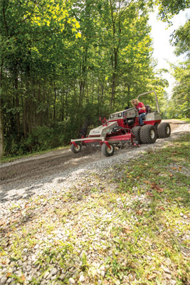 Ventrac 4500Z with Duals working with the Power Rake - Adjustable height and angle make the Power Rake extremely versatile.