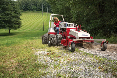 Ventrac 4500 with Dual Wheels uses Power Rake - No matter how overgrown your driveway the Power Rake can help restore it back to it's original condition.