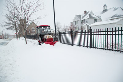 Ventrac 4500 with V-Blade - Sidewalk maintenance is simpler with the V-Blade that adjusts to different widths and conditions.