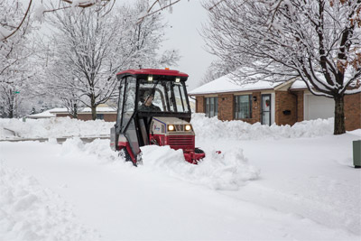 Ventrac 4500Z and Snow Package - The V-Blade slices through snow like a knife while you sit in a warm and dry cab. That's the Ventrac difference.