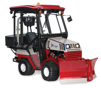Ventrac 4500Z with Snow Package right side - Shown here with V-Blade, Fully enclosed cab, and Broadcast Spreader.