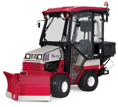 Ventrac 4500Z with Snow Package left side - Shown here with V-Blade, Fully enclosed cab, and Broadcast Spreader.