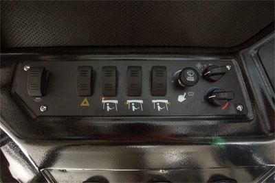 Control Panel for the KW452 Cab - Easy to use and straightforward control panel in the KW452 Cab for the Ventrac 4500 with clearly marked switches and knobs.