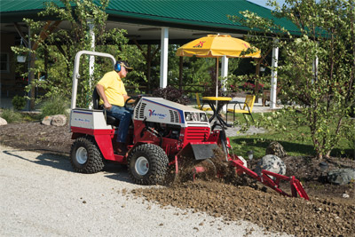 Ventrac 4500 using Trencher - The terminator/cup combo chain offers carbide cutting tips for excellent cutting performance in a variety soil conditions. Digging teeth bolt onto the chain for easy replacement.