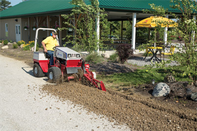 Ventrac 4500 working with the Trencher - Digging teeth bolt onto the chain for easy replacement.