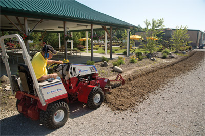Ventrac 4500 and Trencher at work - The KY400 Trencher is capable of trenching up to 40 inches (102 cm) in depth with a 5½ inch (14 cm) wide cut.