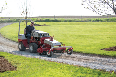Ventrac 4500Y with Power Rake repairing driveway - The KP540 Power Rake is designed for leveling rough ground and new yard installations, as well as removing surface rocks and debris