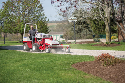 Ventrac 4500Y using KP540 Rake - Evenly distribute and level materials easily with the Power Rake.
