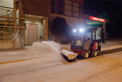 Ventrac 3400 Making Driveways Safe - Reduce the risk of Slip & Fall lawsuits at Hospitals, Schools, Municipalities, and other sites with the Ventrac Power Broom and salt spreader.