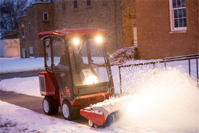 Ventrac 3400 Snow Removal Setup Power Broom - The power broom sweeps away snow from sidewalks efficiently and quickly