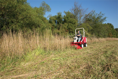 Ventrac 3400Y Mowing Tall Grass - The LQ450 Field Mower is designed to cut heavy grass and small brush growth. Two counter-rotating blades discharge the cut grass to the center rear.