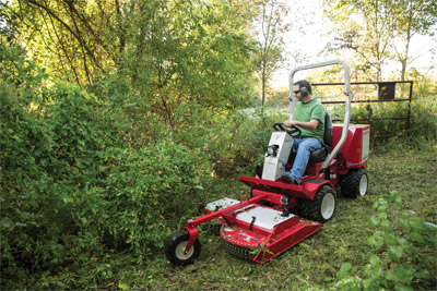 Ventrac 3400 using Field Mower - Suspended front chains allow tall grass to be cut more effectively and reduce the potential for front discharge.