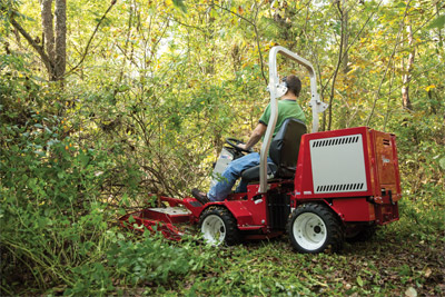 Ventrac 3400 mowing with Field Mower - Large overgrown brush is easily handled by the Field Mower.